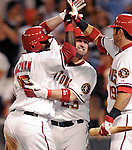 6 June 2007: Washington Nationals shortstop Cristian Guzman (15) celebrates with catcher Brian Schneider (23) and center fielder Ryan Church (19) after Guzman's slide home for the winning run in the bottom of the 9th inning due to a bases loaded wild pitch by the Pittsburgh Pirates at RFK Stadium in Washington, DC. The Nationals defeated the Pirates 6-5 in the second game of their 3-game series...Mandatory Credit: Ed Wolfstein Photo