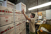 NWA Democrat-Gazette/ANTHONY REYES &bull; @NWATONYR<br /> Patsy Muller, with Northwest Rags, Inc., stacks boxes of rags Wednesday, Sept. 23, 2015 at their facility in Springdale. The comapny ships used clothing all over the world, and has a line of industrial rags, Ozark Recycled Wiping Rags.