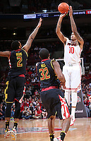 Ohio State Buckeyes forward LaQuinton Ross (10) sinks a 3-point basket over Maryland Terrapins guard Roddy Peters (2) and Maryland Terrapins guard/forward Dez Wells (32) in the first half of the college basketball game between the Ohio State Buckeyes and the Maryland Terrapins at the Jerome Schottenstein Center in Columbus, Wednesday evening, December 4, 2013. As of half time the Ohio State Buckeyes led the Maryland Terrapins 43 - 26. (The Columbus Dispatch / Eamon Queeney)