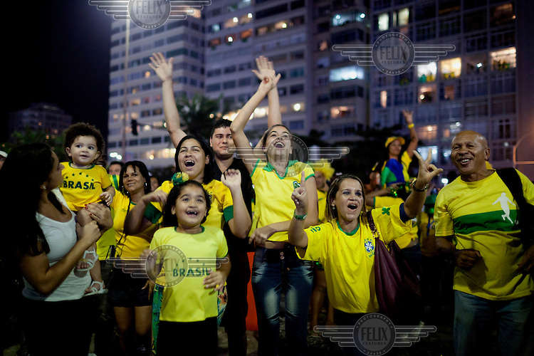 Brazilians and tourists watch the Brazil vs Croatia match in a street on the first day of the FIFA 2014 World Cup.