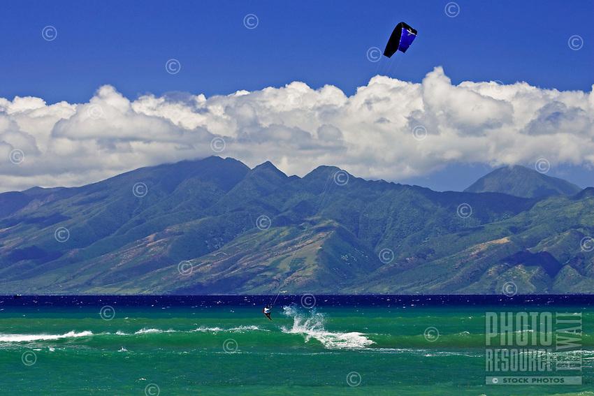 Kitesurfing at Kahana, Maui with the island of Molokai in the background.