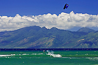Kitesurfing at Kahana, Maui with the island of Molokai in the background.