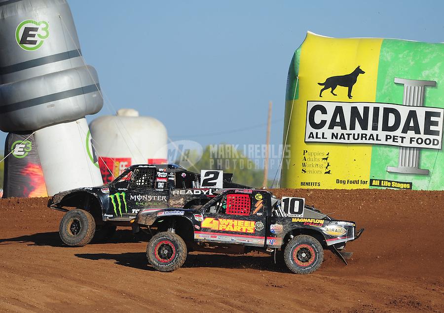 Apr 16, 2011; Surprise, AZ USA; LOORRS driver Jeremy McGrath (2) races alongside Greg Adler (10) during round 3 at Speedworld Off Road Park. Mandatory Credit: Mark J. Rebilas-