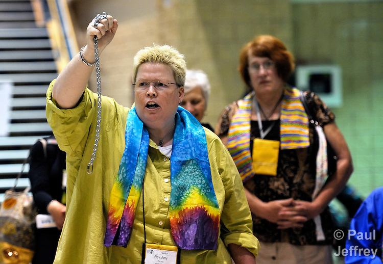 Outside the plenary session of the 2012 United Methodist General Conference in Tampa, Florida, the Rev. Amy DeLong holds chains in her hand as she and others who support the full inclusion of gays and lesbians in the life of the church hold a silent vigil as delegates and visitors leave an April 26 session.