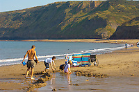 Runswick Bay - North Yorkshire - England - family making sand castles