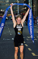28 JUN 2012 - LONDON, GBR - Katie Hewison celebrates winning the women's 2012 Canary Wharf Triathlon in Canary Wharf, London, Great Britain (PHOTO (C) 2012 NIGEL FARROW)