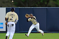 4 March 2012:  FIU outfielder Jabari Henry (14) prepares to catch a fly ball as the FIU Golden Panthers defeated the Brown University Bears, 8-3, at University Park Stadium in Miami, Florida.