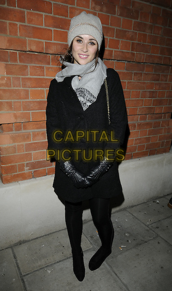 EMMA PIERSON .At the Destroy / Rankin Private View, Phillips de Pury & Co. Howick PLace, London, England, UK, .November 9th 2009..full length black coat tights gloves grey gray hat scarf chanel bag smiling leather .CAP/CAN.©Can Nguyen/Capital Pictures.