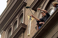 Andy Mykyta from The Cooper Union Engineering School tosses his entry in the Annual Egg Drop Competition on April 29, 2003. The participants had to design and build a device to securely house a raw egg so that it could survive intact a three story drop from the portico of the school's Foundation building. (© Richard B. Levine)