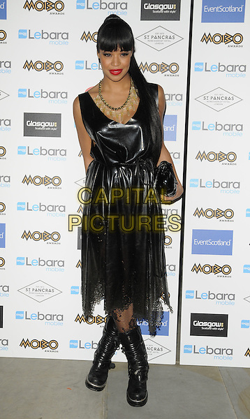 SARAH JANE CRAWFORD.Mobo Nominations at St Pancras International Hotel, London, England.August 31st, 2011.full length black dress lace leather shiny pvc boots .CAP/CAN.©Can Nguyen/Capital Pictures.