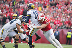 Wisconsin Badgers linebacker Andrew Van Ginkel (17) hits Michigan Wolverines quarterback Brandon Peters (18) during an NCAA College Big Ten Conference football game Saturday, November 18, 2017, in Madison, Wis. The Badgers won 24-10. (Photo by David Stluka)