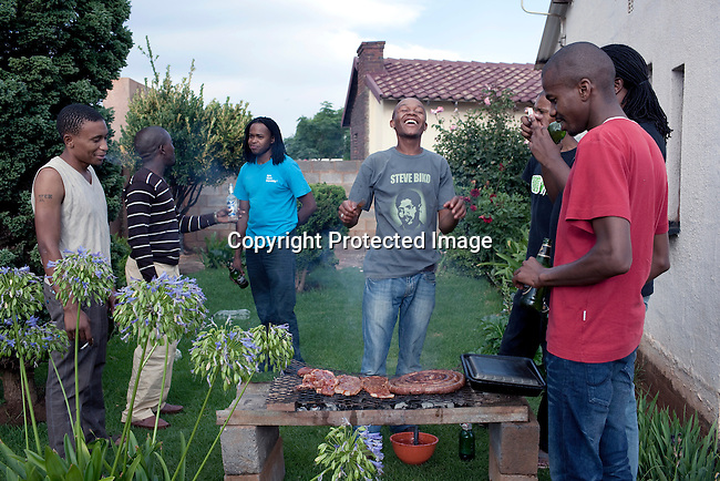 SOWETO, SOUTH AFRICA - JANUARY 16: Thami Nkosi and his closest friends have a braai at friends house in the Dobsonville section on January 16, 2010 in Soweto, South Africa. .(Photo by Per-Anders Pettersson/Getty Images for AFAR Magazine)