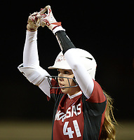 NWA Democrat-Gazette/ANDY SHUPE<br /> Arkansas designated hitter Danielle Gibson celebrates an RBI single against Southeast Missouri Thursday, Feb. 21, 2019, during the fifth inning at Bogle Park on the university campus in Fayetteville.