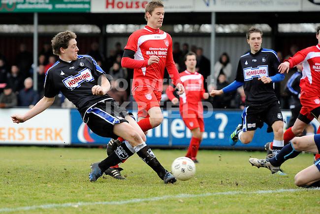 HARKEMA - Voetbal, Harkemase Boys - Spakenburg, sportpark De Bosk, seizoen 2011-2012, 18-02-2012,  Kans voor Spakeburg speler Danny van de Meiracker (l).