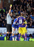 Pictured: Leroy Lita of Swansea (R) sees a yellow card by match refereeKevin Friend (L).  Sunday 16 February 2014<br />
