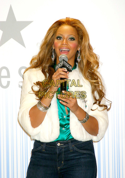 BEYONCE KNOWLES .At The True Star Perfume Launch Held At Macy's, Herald Square, New York City..October 22nd, 2004.half length, white fur coat, microphone, bracelets, bangles.www.capitalpictures.com.sales@capitalpictures.com.©Capital PIctures