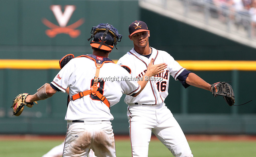 John Hicks (8) and Branden Kline (16) celebrate Virginia's 4-1 win over California on June 19, 2011 at the College World Series in Omaha, Neb. (Photo by Michelle Bishop).