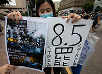 An anti-Extradition Bill protestor holds up a sign calling for a general strike on Monday 05 August 2019 during a protest in Tsim Sha Tsui, Kowloon, Hong Kong, China, 04 August 2019.