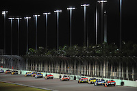 Nov. 14, 2008; Homestead, FL, USA; NASCAR Craftsman Truck Series drivers race down the backstretch during the Ford 200 at Homestead Miami Speedway. Mandatory Credit: Mark J. Rebilas-