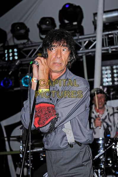 GUILDFORD, ENGLAND - JULY 18: Jimmy Pursey of Sham 69 performs live at Guilfest, Stoke Park, Guildford on July 18, 2014 in Guildford, England.<br /> CAP/MAR<br /> &copy; Martin Harris/Capital Pictures