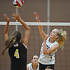 Diana Farrell #7 of Lynbrook attempts to spike past Courtney Cardona #4 of Wantagh during a Nassau County Conference A1 varsity girls volleyball match at Lynbrook High School on Thursday, Sept. 8, 2016. Wantagh won the match 3-1.