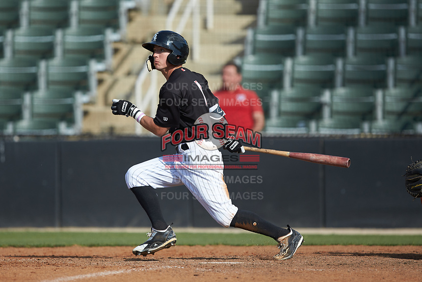 Tyler Frost (1) of the Kannapolis Intimidators follows through on his swing against the Hagerstown Suns at Kannapolis Intimidators Stadium on May 6, 2018 in Kannapolis, North Carolina. The Intimidators defeated the Suns 4-3. (Brian Westerholt/Four Seam Images)