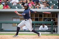 Eric Young Jr. (14) of the Gwinnett Braves follows through on his swing against the Charlotte Knights at BB&T BallPark on July 3, 2015 in Charlotte, North Carolina.  The Braves defeated the Knights 11-4 in game one of a day-night double header.  (Brian Westerholt/Four Seam Images)