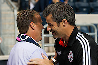 Toronto FC head coach Ryan Nelsen talks with Philadelphia Union manager John Hackworth. The Philadelphia Union defeated Toronto FC 1-0 during a Major League Soccer (MLS) match at PPL Park in Chester, PA, on October 5, 2013.