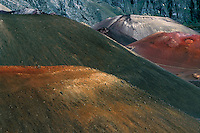 HALEAKALA NATIONAL PARK on Maui in Hawaii is home to many multi colored cinder cones that dominate the wilderness landscape