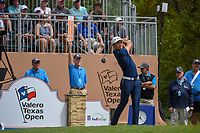 HaoTong Li (CHN) watches his tee shot on 1 during day 1 of the Valero Texas Open, at the TPC San Antonio Oaks Course, San Antonio, Texas, USA. 4/4/2019.<br /> Picture: Golffile | Ken Murray<br /> <br /> <br /> All photo usage must carry mandatory copyright credit (© Golffile | Ken Murray)