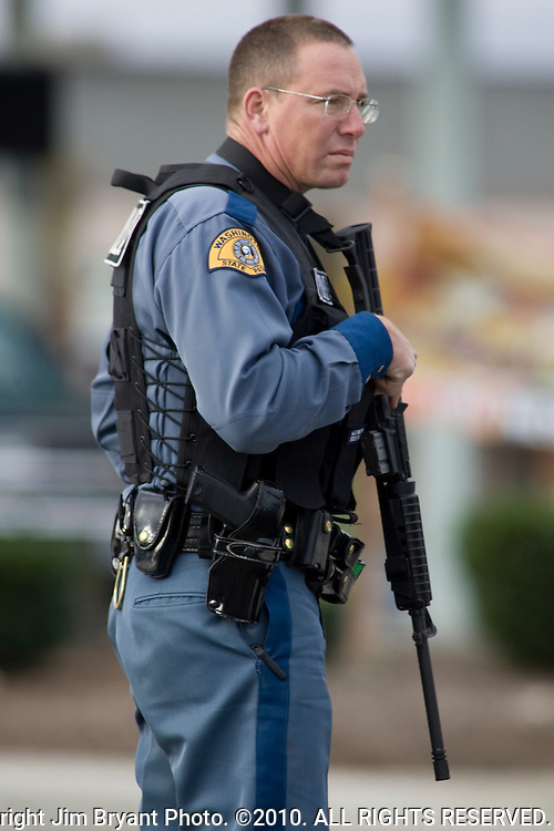 A Washington State Patrolman mans a roadblock near the scene of a shooting that killed four Lakewood Police Officers in Lakewood on Sunday, Nov. 29, 2009.  At about 8:00 this morning, a gunman walked into the Fornza Coffee shop while the four police officers were having coffee before their shift started and opened fire, killing all our law enforcement. Jim Bryant Photo. ©2010. ALL RIGHTS RESERVED.