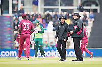 Umpires Rod Tucker and Paul Wilson consult as the rain worsens and take the decision to leave the field during South Africa vs West Indies, ICC World Cup Cricket at the Hampshire Bowl on 10th June 2019