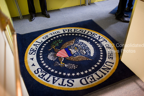 United States President Barack Obama, upper right, stands near a carpet bearing the presidential seal before making remarks at a political fundraiser in Washington, D.C., Thursday, February 4, 2010. .Mandatory Credit:  Lawrence Jackson - White House via CNP