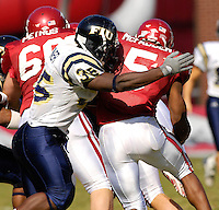 Florida International University Golden Panthers versus the University of Arkansas Razorbacks at Donald W. Reynolds Razorback Stadium, Fayetteville, Arkansas on Saturday, October 27, 2007.  The Razorbacks defeated the Golden Panthers, 58-10...FIU's Trenard Turner (35) (Miami, Fla.) tackles Arkansas tailback Darren McFadden (5).
