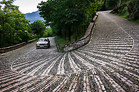 Albania. Gjirokastër. A Mercedes on the old road going to the Gjirokastër Castle which is a fortress overlooking the city. Gjirokastër is a city in southern Albania. 24.05.2018 © 2018 Didier Ruef