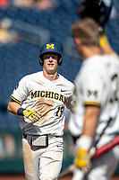 Michigan Wolverines first baseman Jimmy Kerr (15) jogs around third base after hitting his second home run of the game against the Texas Tech Red Raiders in the NCAA College World Series on June 21, 2019 at TD Ameritrade Park in Omaha, Nebraska. Michigan defeated Texas Tech 15-3 and will play in the CWS Finals. (Andrew Woolley/Four Seam Images)
