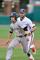 Third baseman Max McDougald (26) of the Wofford University Terriers is caught in a rundown as second baseman Weston Wilson (8) of the Clemson University Tigers makes the tag in a game on Tuesday, March 1, 2016, at Doug Kingsmore Stadium in Clemson, South Carolina. Clemson won, 7-0. (Tom Priddy/Four Seam Images)