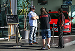 """Greg Murphy and Mullet owner Daniel McNicholl. Holden New Zealand, """"Mullet Amnesty Day"""", trade your mullet for a Holden Astra, West City Holden, Auckland, New Zealand, Saturday 1st April 2017. Photo: Simon Watts/www.bwmedia.co.nz"""