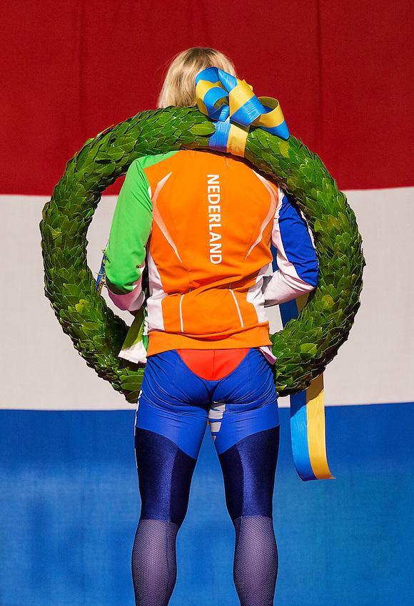 Koen Verweij listens to the Dutch National Anthem on the podium after winning the overall standing of the Essent ISU speed skating world championship in Heerenveen March 23, 2014.REUTERS/Michael Kooren (NETHERLANDS - Tags: SPORT SPEED SKATING)