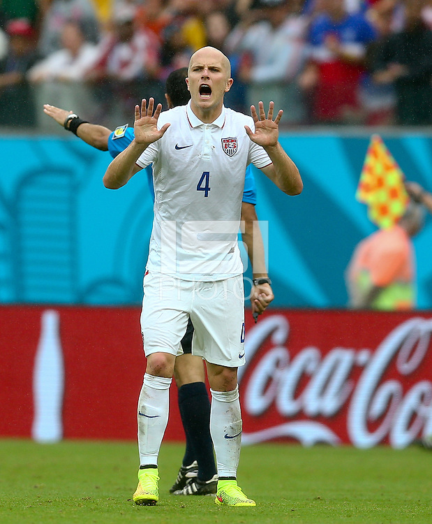 Michael Bradley of USA calms his players down