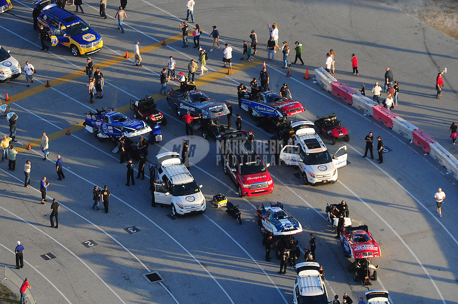 Jan. 21, 2012; Jupiter, FL, USA: Aerial view of the cars of NHRA funny car drivers Robert Hight (left), Cruz Pedregon (middle) and Bob Tasca III in the staging lanes during testing at the PRO Winter Warmup at Palm Beach International Raceway. Mandatory Credit: Mark J. Rebilas-