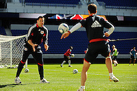 New York Red Bulls strength and fitness coach Jeremy Holsopple works out Juan Pablo Angel (9) during a practice at Red Bull Arena in Harrison, NJ, on March 16, 2010.