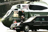 President George W. Bush  waves as he departs Marine One and heads for his brand new Cadillac limousine in order to participate in  a panel to discuss his health care plan at the National Institute of Health in Bethesda, Maryland on January 26, 2005.<br /> Credit: Dennis Brack / Pool via CNP