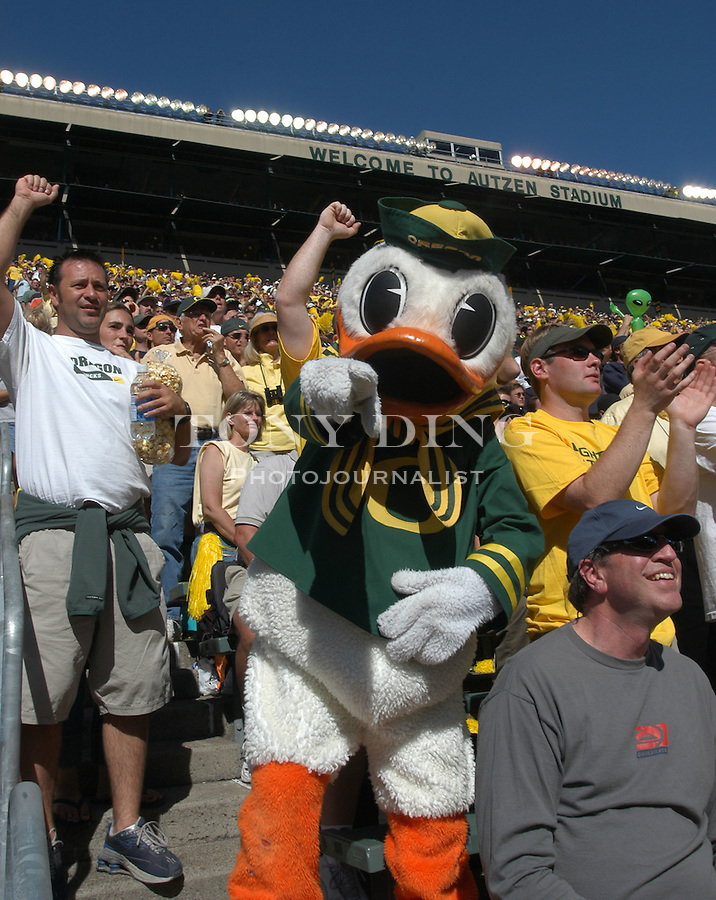 Donald Duck, the University of Oregon mascot, pump up the already crazed crowd during the Oregon Duck's 31-27 upset of the Michigan Wolverines in Eugene, OR, on Saturday, September 20, 2003. (TONY DING/Daily)