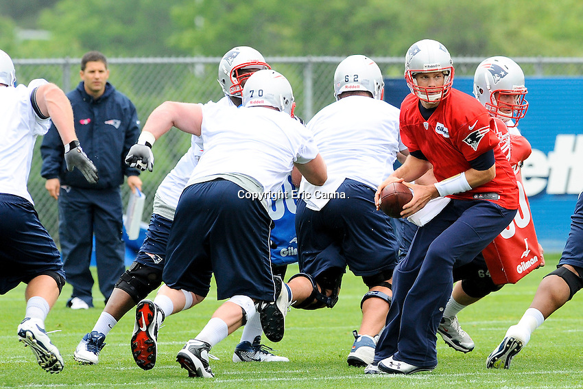 New England Patriots quarterback Tom Brady (12) works with the offense  during the New England Patriots Organized Team Activities held at Gillette Stadium in Foxborough Massachusetts.  Eric Canha/CSM