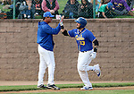 SIOUX FALLS, SD, MAY 20:  David Bergin #13 from the Sioux Falls Canaries gets is congratulated by the third base coach after a solo home run in the fourth inning against the Sioux City Explorers Friday night at the Sioux Falls Stadium. (Photo by Dave Eggen/Inertia)