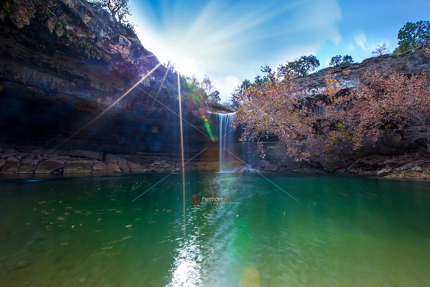 Hamilton Pool Nature Preserve is a scenic natural swimming pool in a canyon below a 50-foot waterfall, surrounded by a grotto. It's a beautiful and beloved popular summer swimming hole, is a must see for locals and tourist alike.