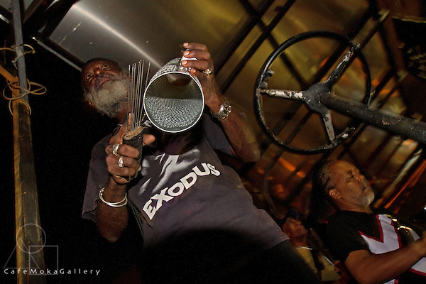 Exodus rhythm setction - elder playing a metal sieve. Pan in the streets. 2014, Port of Spain, Trinidad