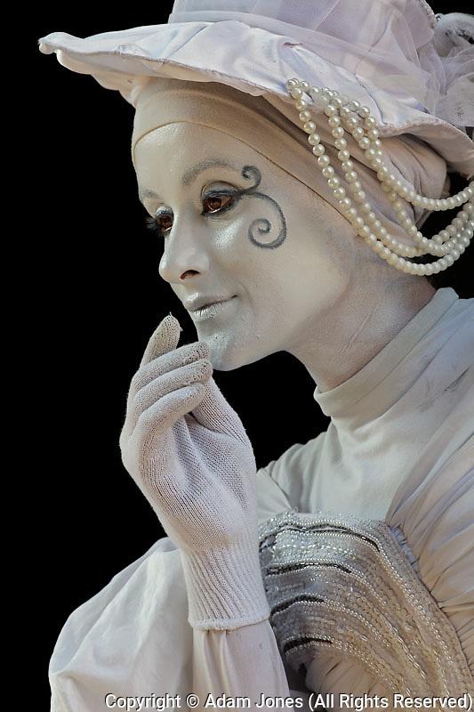 Female mime performing on street corner, Monteriggioni, Italy, Tuscany