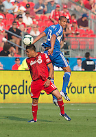 03 July 2013: Toronto FC midfielder Luis Silva #11 and Montreal Impact defender Matteo Ferrari #13 in action during an MLS game between the Montreal Impact and Toronto FC at BMO Field in Toronto, Ontario Canada.